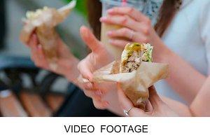 Caucasian women fast food sandwich