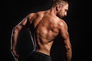 Bodybuilder Posing. Back muscles