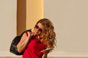 Girl in red dress, phone, handbag