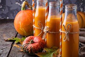 Bottles of healthy pumpkin juice