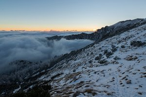 Fog in mountains at sunset