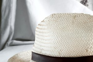 Straw hat on white table