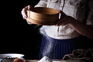 Woman sifting flour