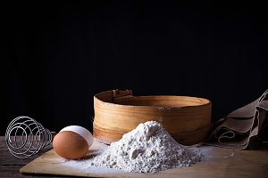 Flour, sieve and eggs