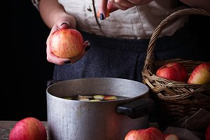 Woman cooking apple cider