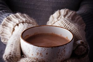Woman holding a cup of hot chocolate