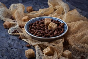 Coffee beans and brown cane sugar