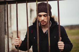 Attractive guy behide the bars