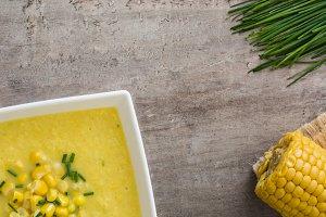 Corn soup in white bowl