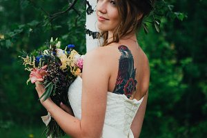 portrait of a bride on background leaves and forest