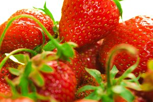 fresh strawberries closeup on the blurry background