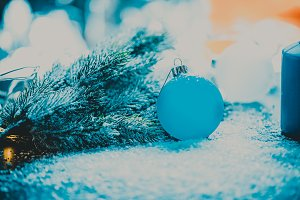 Blue Christmas tree ball next to the branch
