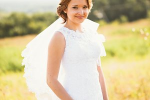 portrait of a young bride on the background the field