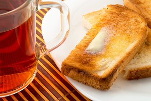 Mug of tea and hot toast