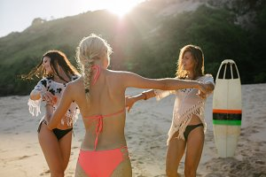 Women having fun on the beach party