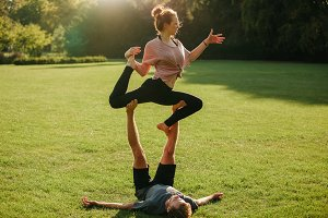 Man and woman doing various yoga