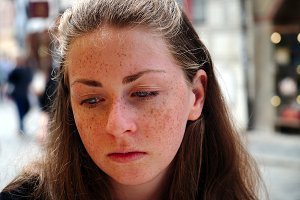 Portrait of sad freckly girl