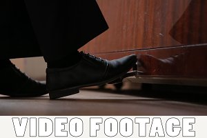 Musician foot is presses piano pedal