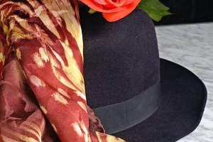 Black hat with a scarf