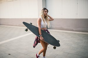 Casual young woman and longboard