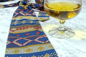 Colored tie with a glass of brandy