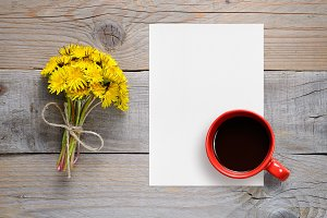 Dandelions, blank paper and coffee