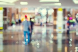 Blurred Background: people go for Shopping Mall along the window