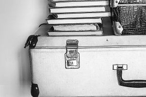 Vintage composition of old suitcases, stools and books.