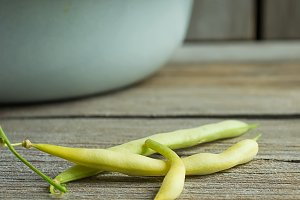 Fresh organic yellow beans on a wooden background