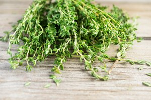 Sprigs of thyme on an old wooden background