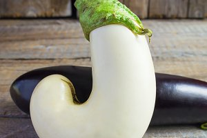 A pair of eggplants on rustic background