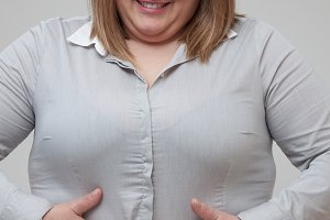 Woman hiding belly fat