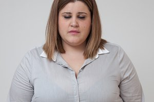Overweight woman with closed eyes