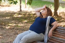 Fatigued woman on a bench