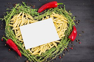 Pasta and Italian ingredients on a dark background.