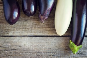 Ripe eggplant on old wooden background, With space for text