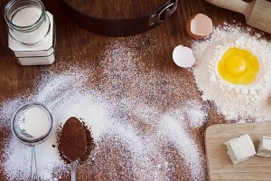 baking background - egg, flour, sugar, butter, cocoa.