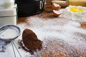 baking background - egg, flour, sugar, cocoa. Space for text