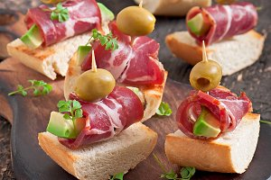 Toast with ham, avocado and olives