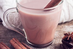 Hot cocoa with cinnamon sticks  on white background