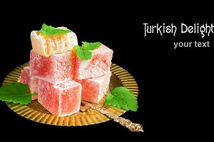 Turkish delight on a metal plate in an oriental style.