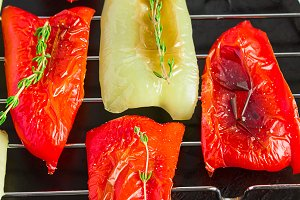 red and green peppers grilled on a black background