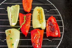 red and light green peppers grilled on a black background