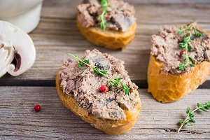 Baked chicken pate with thyme and mushrooms, toast,