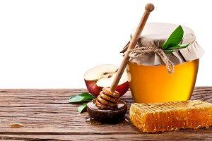Glass can full of honey, apples
