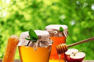Glass cans full of honey, apple