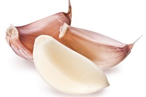Peeled garlic clove isolated