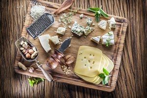 Different types of cheeses with nuts