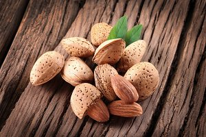 Almond nuts with leaves. Isolated on a white background.