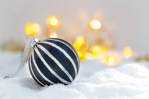 Blue Christmas ball in the snow